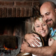 Stock Photo: Couple near a fireplace