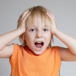 The shouting emotional boy — Stock Photo