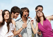 Group of young guys and girls having fun — Stock Photo