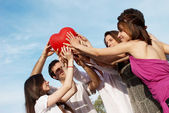 Group of young guys and girls — Stock Photo