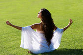 Meditation on a green field — Stock Photo
