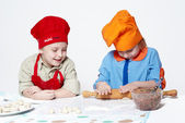 Small chefs, working with the dough — Stock Photo