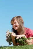 Girl with bunches of flowers — Stock Photo