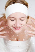 Happy young girl wash her face — Stock Photo