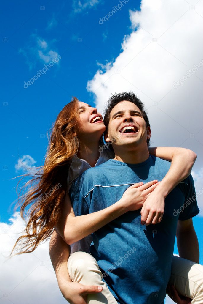 Happy Young couple against the sky — Stock Photo #1950218
