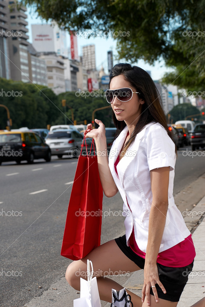 Beautiful young woman with her shopping bags — Stock Photo #1952383