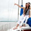 Stock Photo: Young couple onboard yacht