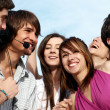 Stock Photo: Group of young guys and girls