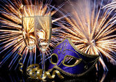 Glasses with champagne and mask — Stock Photo