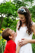 Young boy and pregnant mom — Stock Photo
