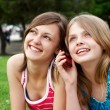 Two girlfriends in park — Stock Photo