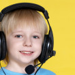 The emotional kid in ear-phones — Stock Photo