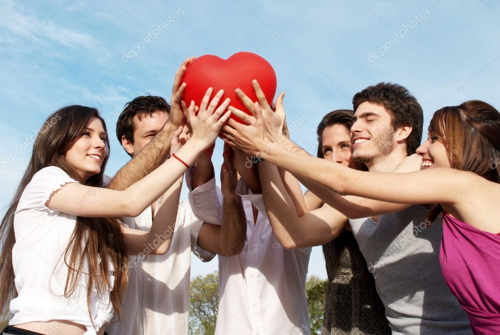 Group of young guys and girls with a sphere in the form of heart — Zdjęcie stockowe #2330054