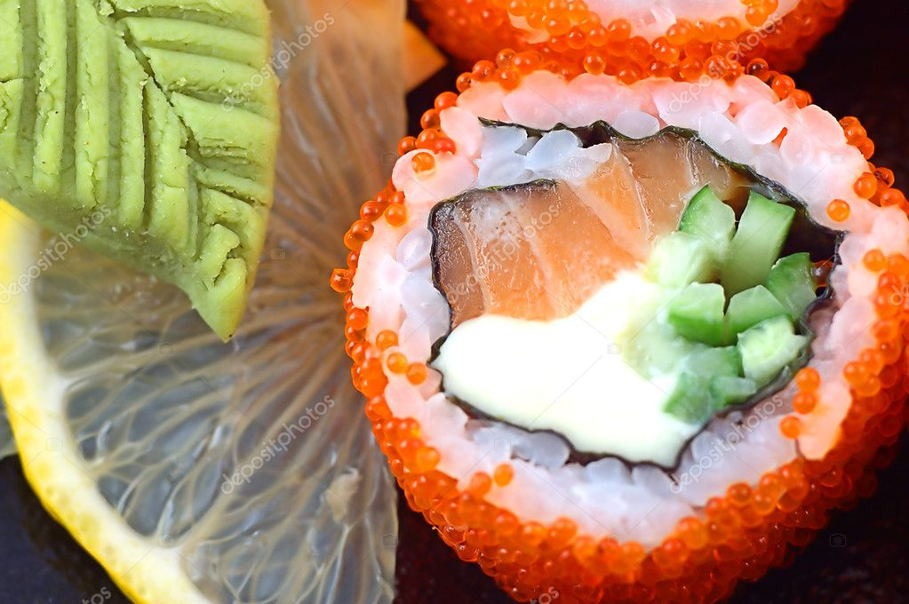 Sushi close up with a slice of a lemon and a red fish — Stock Photo #2138911