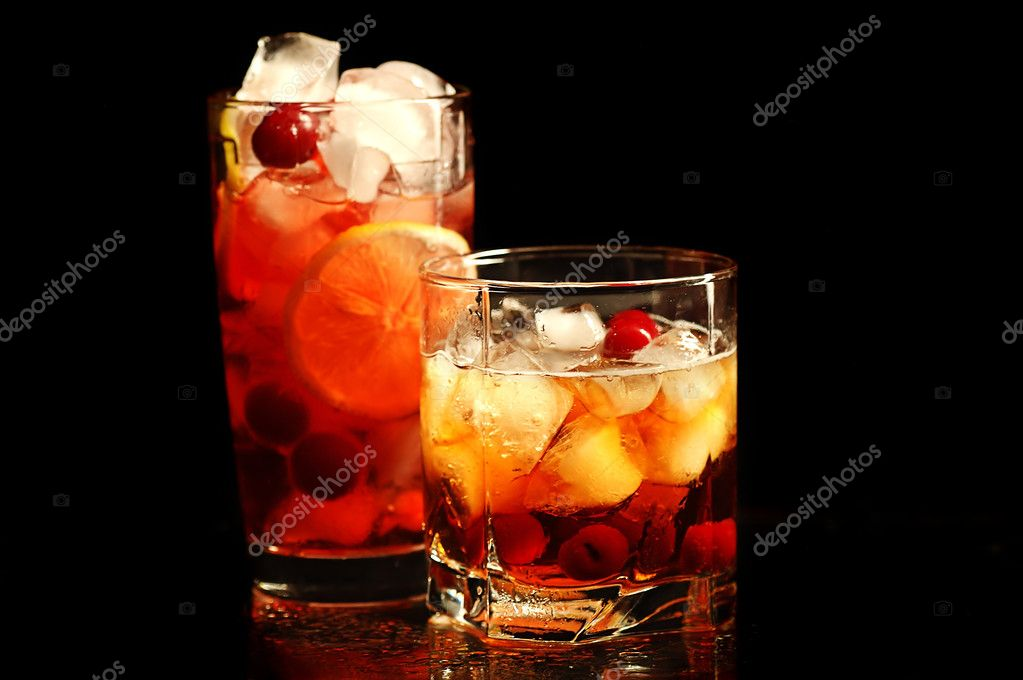 Freshening drink with ice and a lemon in a glass on a black background  Stock Photo #2170207