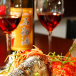 Fish with red wine — Stock Photo