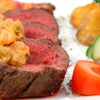 Meat with blood and vegetables — Stock Photo