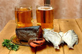 Beer and fishes — Stock Photo