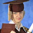 Stock Photo: Graduate with diploma