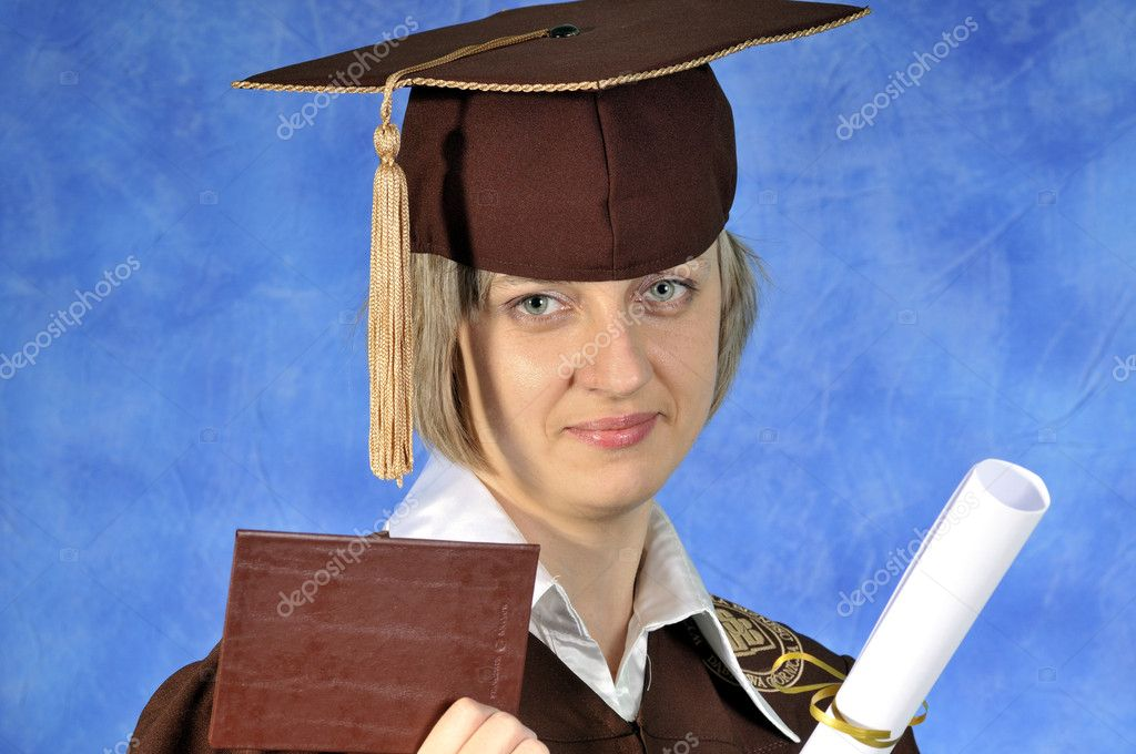 Young female in graduation gown holding her diploma — Stock Photo #1929540