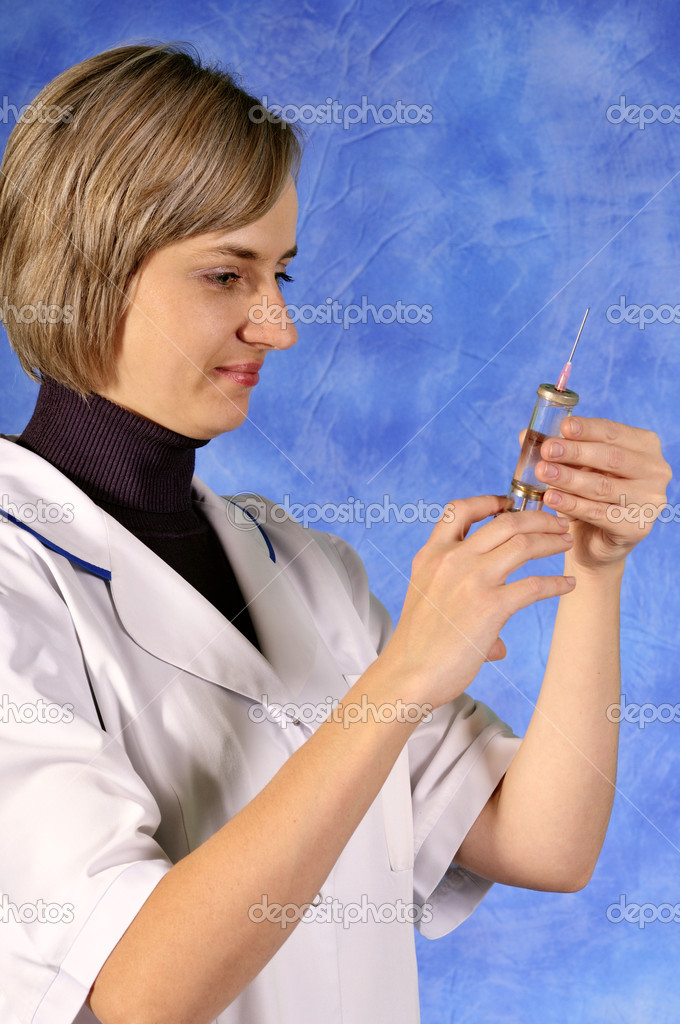 Nurse or doctor with syringe — Stock Photo #1932178