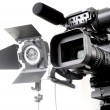 Dv camcorder and light - Stockfoto