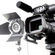 Dv camcorder and light — Stock Photo