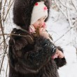 Little girl on the snow — Stock Photo #1772632