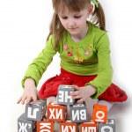 Girl play with bricks — Stock Photo