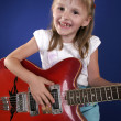 Little girl and guitar — Stock Photo