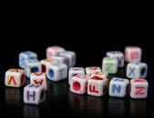 Briques de jouet avec des lettres — Photo