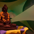 Royalty-Free Stock Photo: Buddha statue on green background