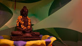 Buddha statue on green background — Stock Photo