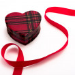 Gift heart with red ribbon — Stock Photo