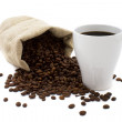 Cup of coffee and a bag of coffee beans — Stock Photo