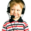 Young boy in headphones with microphone — Stock Photo
