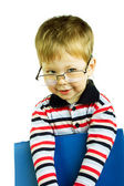 Young boy wearing glasses with a folder — Stock Photo
