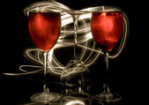 Glasses of red wine in the rays of light — Stock Photo