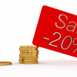 Discounted card and gold money — Stock Photo