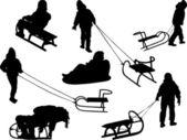 Silhouettes of children sledding — Stock Vector