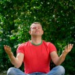 Man sitting in lotus position — Stock Photo
