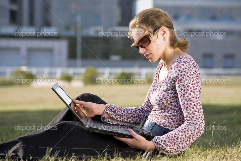 Businesswoman working over a laptop computer — Stock Photo #1783504
