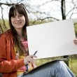 Stock Photo: Girl keeping clean sheet of paper
