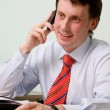 The young businessman speaks by phone — Stock Photo