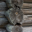 Fragment of  wall of house from old logs - Stock Photo