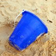 Bucket in Sand - Stockfoto