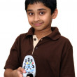 An handsome Indian kid turn off the remote — Stock Photo #1891189
