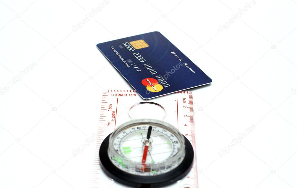 Compass pointing to credit card isolated  Stock Photo #2436056