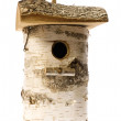 Isolated birdhouse nestles — Stock Photo