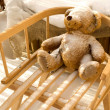 Teddy Bear toy and slide with snow covering — Stock fotografie